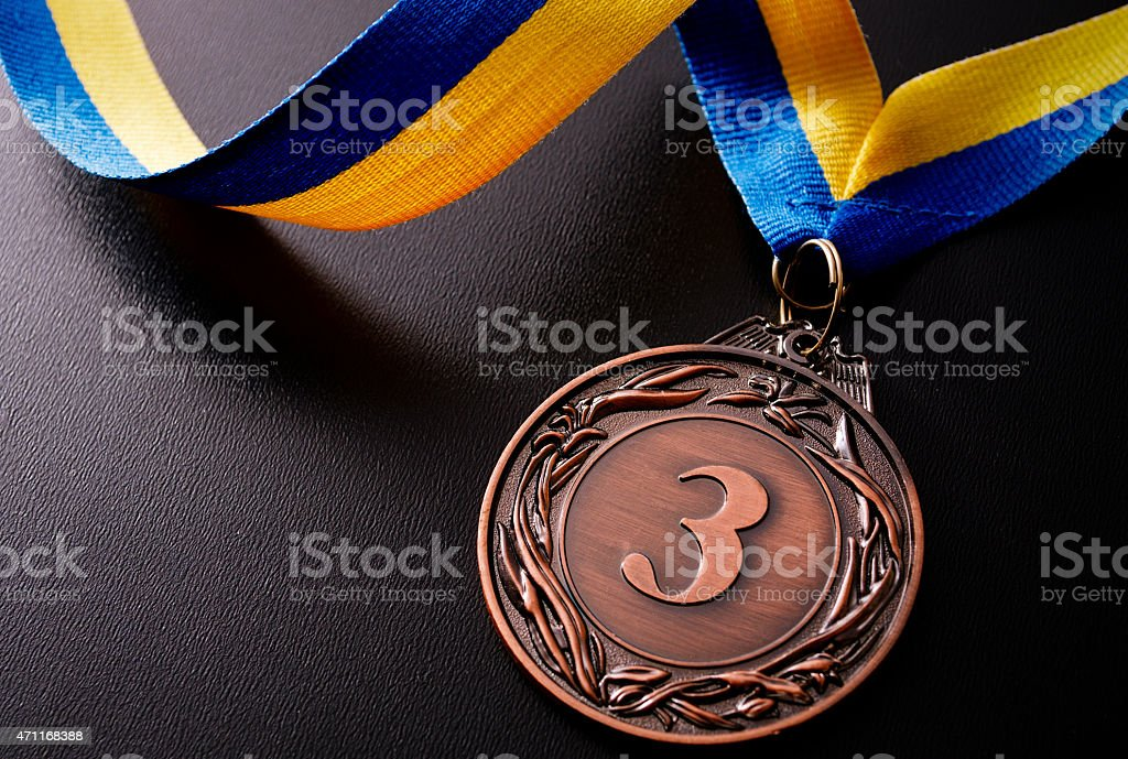 Bronze medal on a dark background stock photo