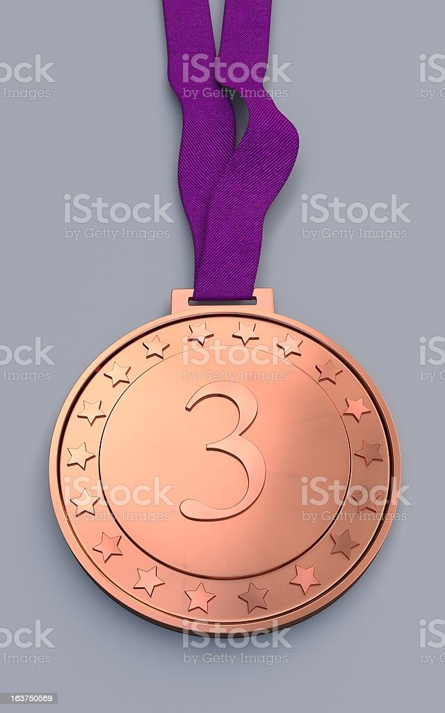 Bronze medal with number on a purple ribbon royalty-free stock photo