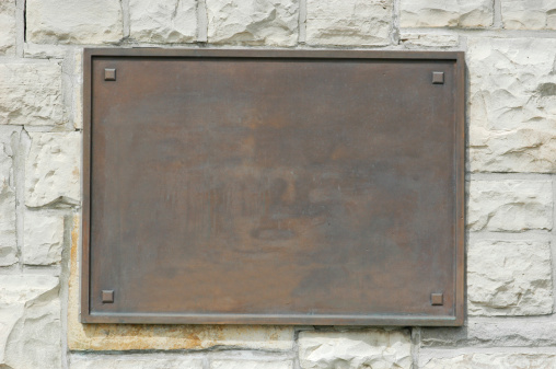 Bronze plaque on stone wall. Add your own text or image. Clipping path included to isolate the sign from the wall.