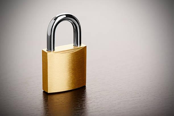 Bronze Padlock Bronze padlock on table closeup padlock stock pictures, royalty-free photos & images