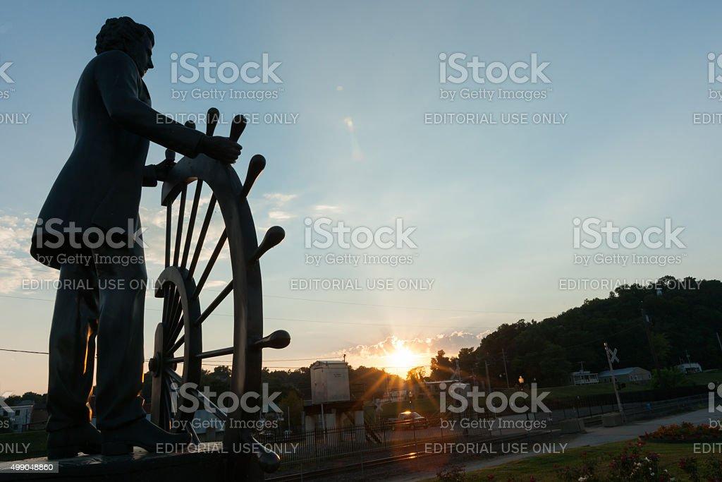 Bronze public art statue in Glascock's Landing looking over Miss stock photo