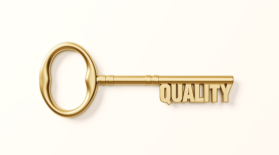 Bronze quality key on white background. Horizontal composition with clipping path.