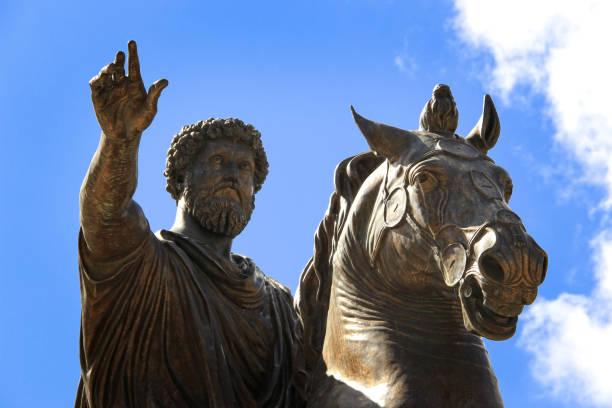 Bronze Roman equestrian statue of Emperor Marcus Aurelius, against the blue sky stock photo
