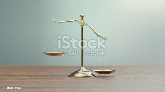 824305956 istock photo Bronze Scale Standing in Front of Defocused Background 1248049606