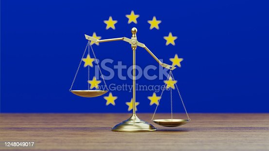 824305956 istock photo Bronze Scale Standing in Front of European Union Flag 1248049017