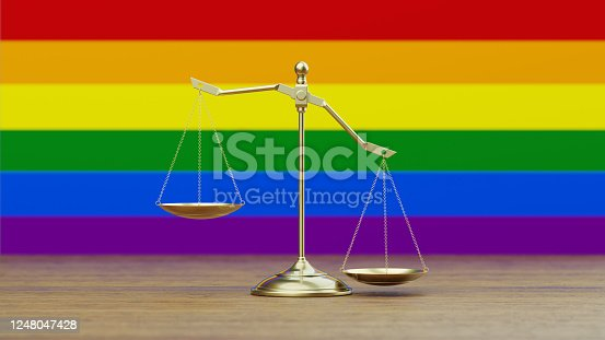 824305956 istock photo Bronze Scale Standing in Front of LGBTI Flag 1248047428