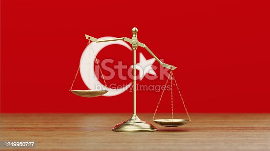 824305956 istock photo Bronze Scale Standing in Front of Turkish Flag 1249950727