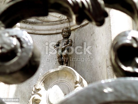 Bronze Sculpture of Manneken Pis as View Through the Iron Fence, a Small but Famous Landmark of Brussels of Belgium