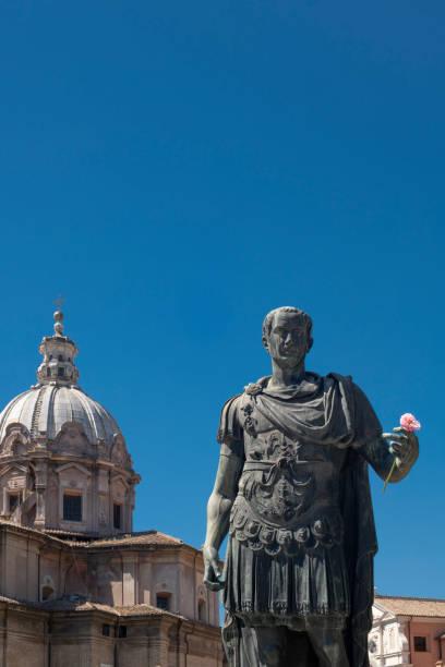 Bronze sculpture of Roman emperor Julius Caesar holding flower stock photo