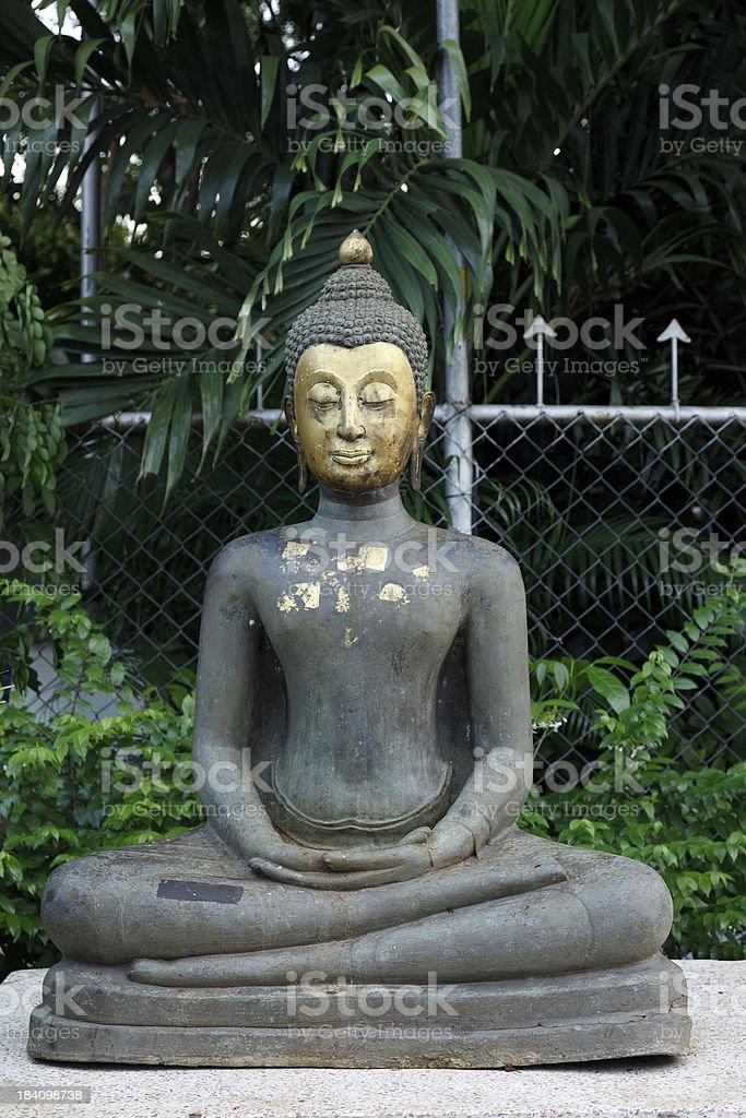 Bronze seated meditating Thai Buddha stock photo