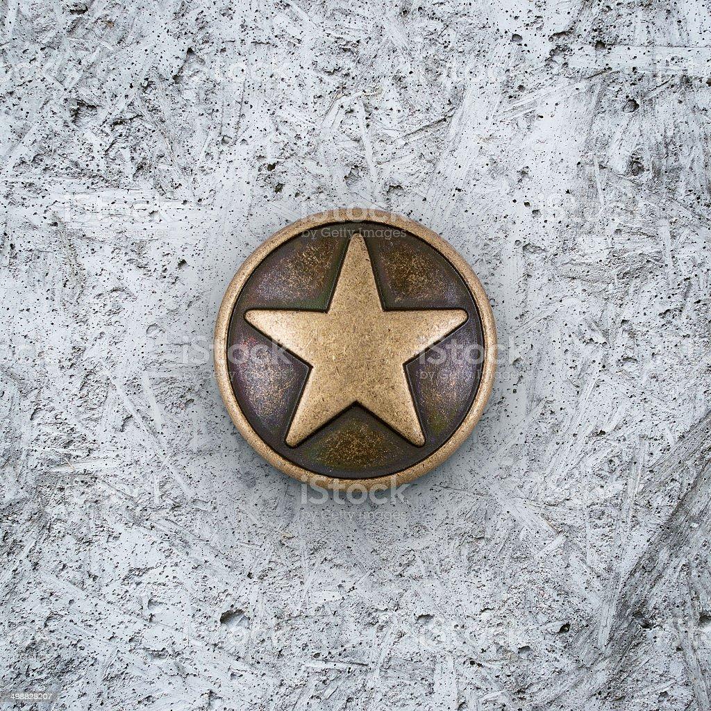 Bronze star on cement background stock photo