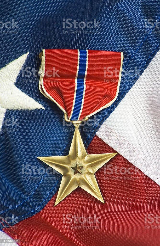 Bronze star on USA flag stock photo