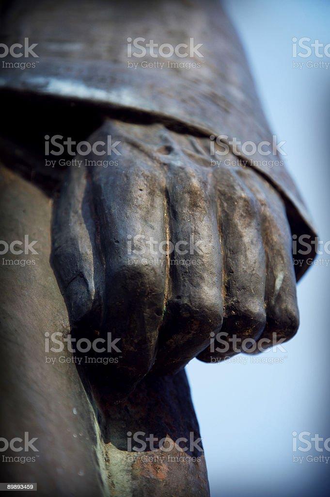 bronze statue hand fist royalty-free stock photo