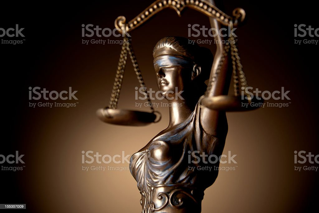 A bronze statue of lady justice stock photo