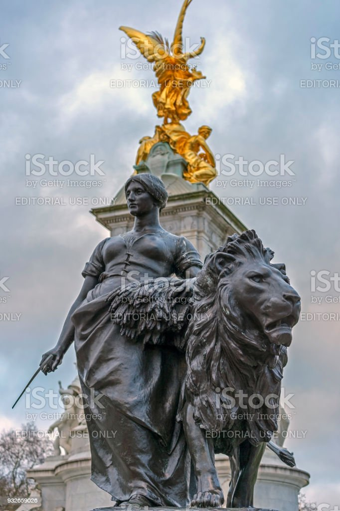 Bronze statues around the Queen Victoria Memorial in front of the Buckingham Palace stock photo