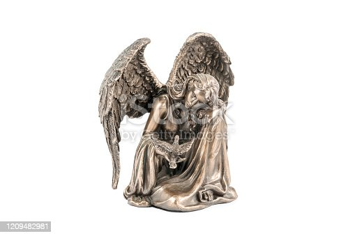 bronze statuette of a sitting girl - an angel with a bird in her hand, isolated on white background