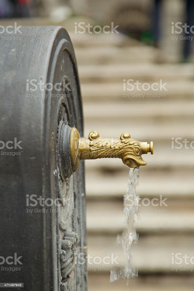 Bronze tap of public fountain. Padua-Italy royalty-free stock photo