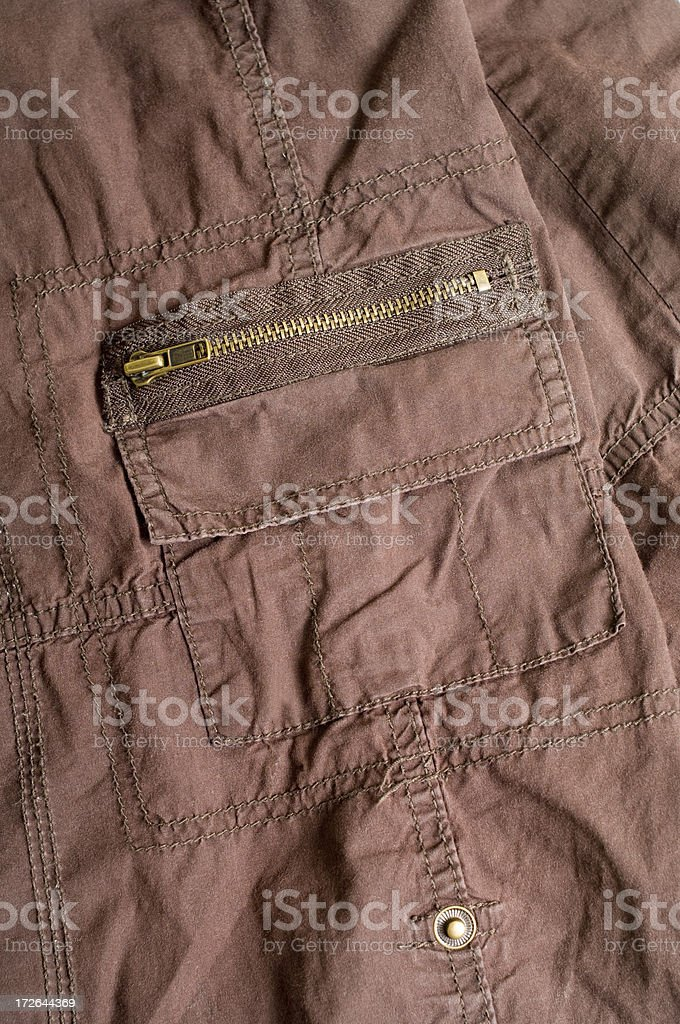 Bronzed Zipper and Pocket royalty-free stock photo