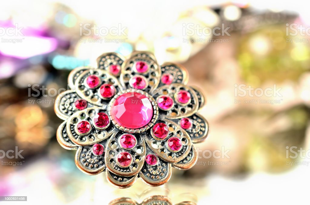 Brooch - richly decorated, red artificial stones - close-up stock photo