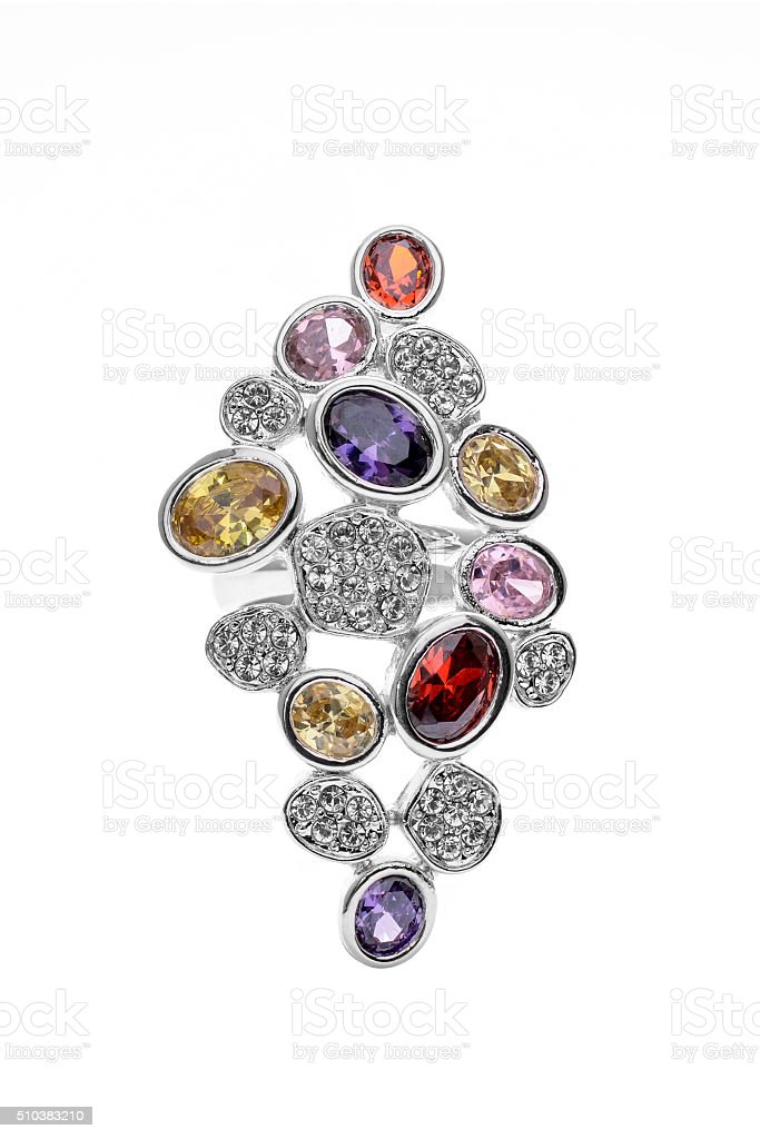 brooch with colored stones on a white background stock photo