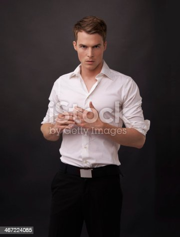 Portrait of a handsome young man against a black background