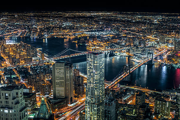 Brooklyn and Manhattan Bridge aerial view at night Aerial view of Brooklyn and Manhattan bridges with wide surrounding areas around them on a cold winter night. lower manhattan stock pictures, royalty-free photos & images