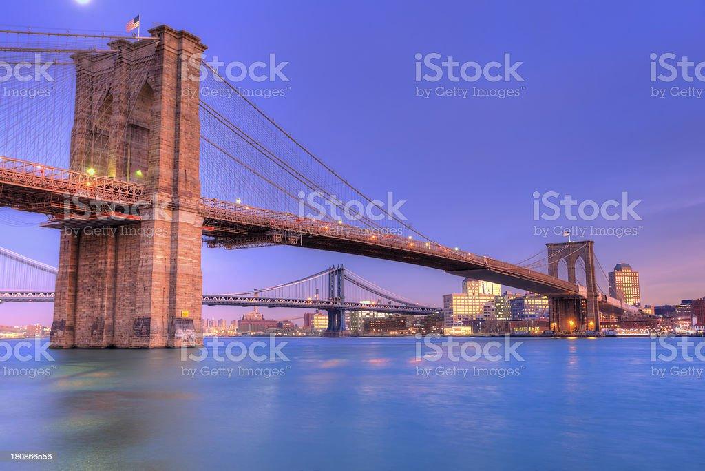 Brooklyn and Manhattan bridges during sunset royalty-free stock photo