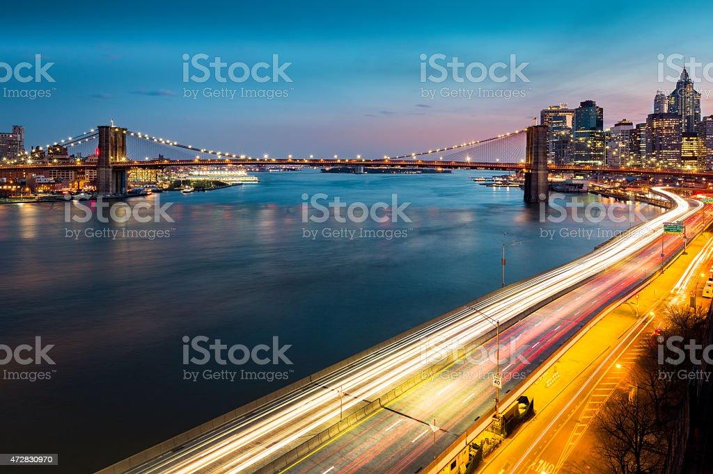 Brooklyn Bridge and FDR drive at dusk stock photo