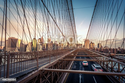 496266816 istock photo Brooklyn Bridge and Lower Manhattan at Sunrise, New York City 496266584