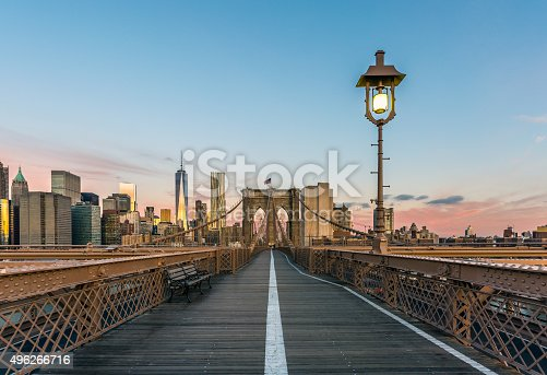496266816 istock photo Brooklyn Bridge and Lower Manhattan at Sunrise, New York City 496266716