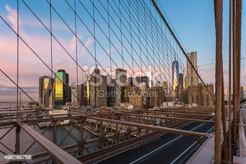 496266816 istock photo Brooklyn Bridge and Lower Manhattan at Sunrise, New York City 496266758