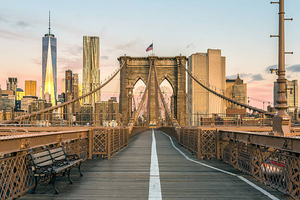 brooklyn bridge and lower manhattan at sunrise, new york city - international landmark stock photos and pictures