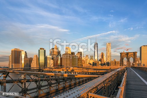 496266816 istock photo Brooklyn Bridge and Lower Manhattan at Sunrise, New York City 819453782