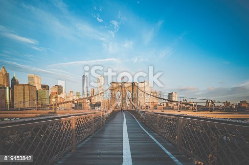 496266816 istock photo Brooklyn Bridge and Lower Manhattan at Sunrise, New York City 819453842
