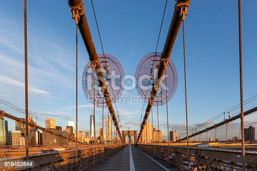 496266816 istock photo Brooklyn Bridge and Lower Manhattan at Sunrise, New York City 819453844