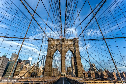 496266816 istock photo Brooklyn Bridge and Lower Manhattan at Sunrise, New York City 819484316