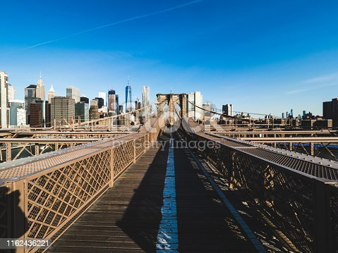 Brooklyn Bridge and Lower Manhattan at sunrise, New York City, USA