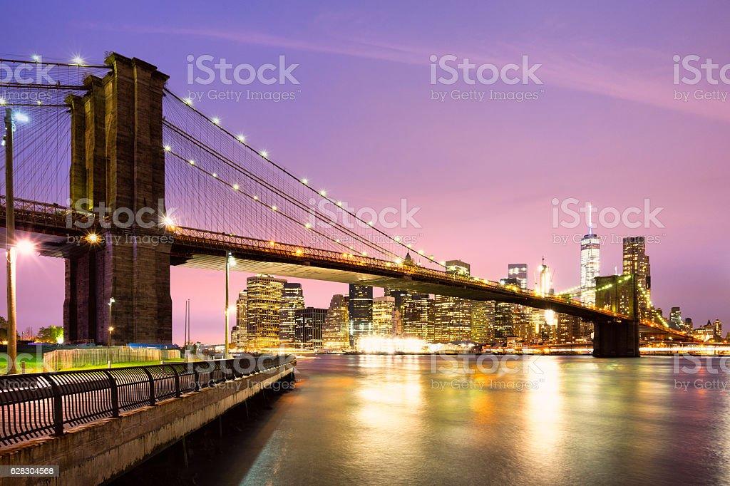 Brooklyn Bridge and Manhattan at night stock photo
