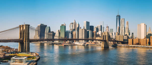 Brooklyn bridge and Manhattan at sunny day Brooklyn bridge and Manhattan at sunny day, New York City new york state stock pictures, royalty-free photos & images