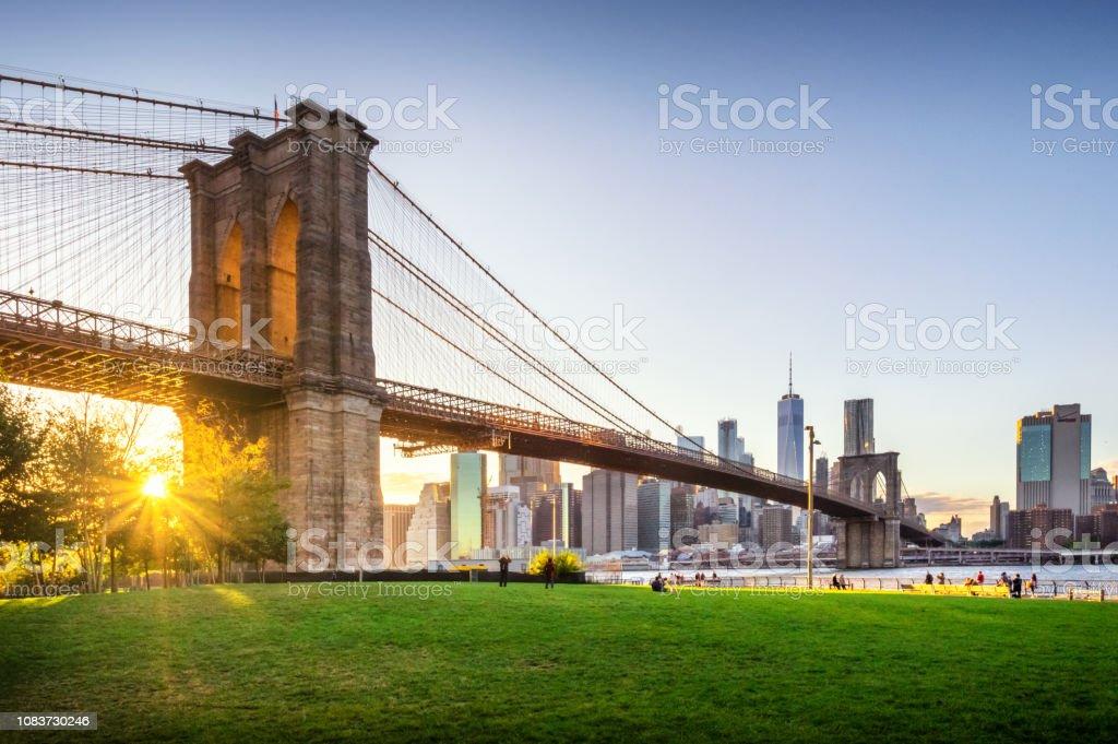 Brooklyn Bridge and Manhattan at sunset. NYC stock photo
