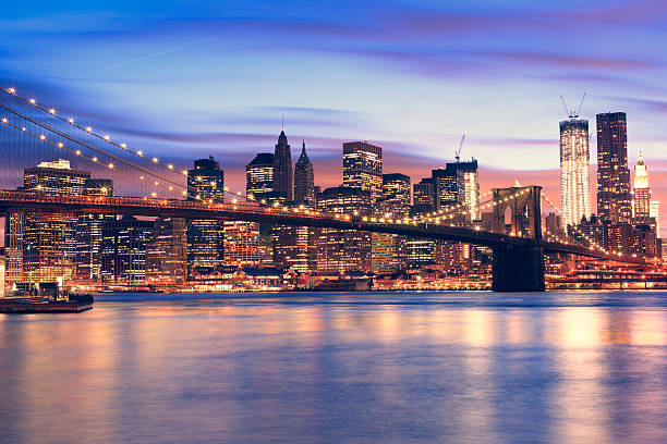 Brooklyn Bridge and Manhattan at sunset Brooklyn Bridge and Manhattan at sunset south street seaport stock pictures, royalty-free photos & images