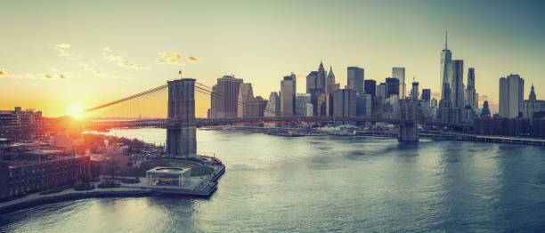 brooklyn bridge and manhattan at sunset - new york city stock pictures, royalty-free photos & images