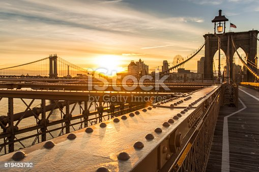 496266816 istock photo Brooklyn Bridge and Manhattan Bridge at Sunrise, New York City 819453792