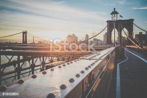 496266816 istock photo Brooklyn Bridge and Manhattan Bridge at Sunrise, New York City 819453804