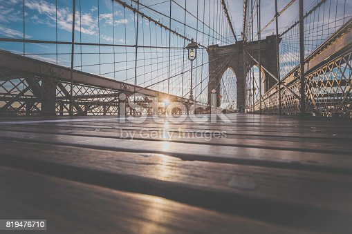 496266816 istock photo Brooklyn Bridge and Manhattan Bridge at Sunrise, New York City 819476710