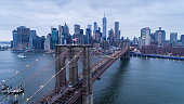 Drone photo at sunset of the Brooklyn Bridge with Manhattan in the background.