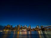 Brooklyn Bridge and Manhattan skyline in a night