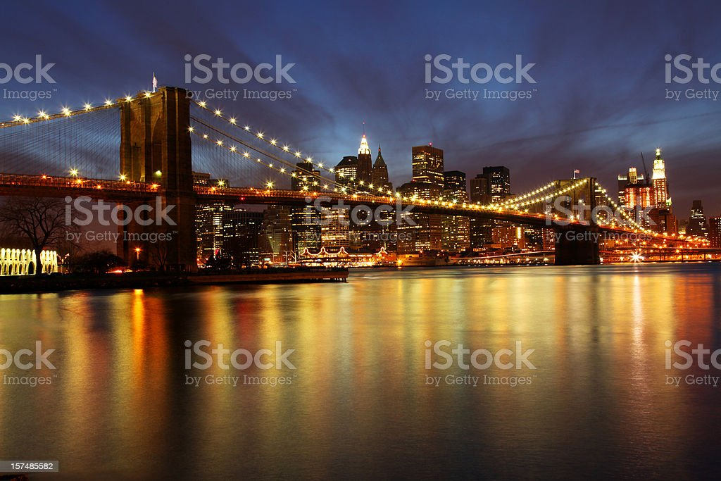 Brooklyn Bridge and Manhattan skyline, New York City at dusk royalty-free stock photo