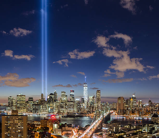 Brooklyn Bridge and Manhattan skyline with The Tribute in Light stock photo