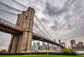 istock Brooklyn Bridge and Manhattan with clouds. NYC 1277105942